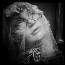 Spectacles Under a Veil